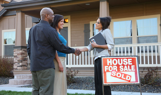 House Sold Handshake Couple